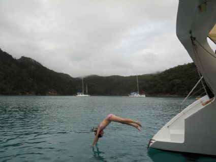 Diving off the boat for an early morning swim