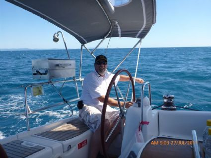 Skipper at the helm