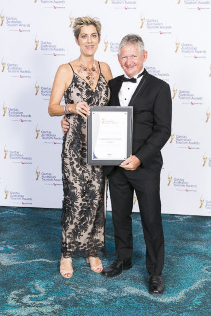 Sharon and Charlie accepting the silver award for Unique Accommodation at the Australian Tourism Awards